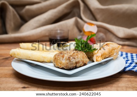 Typical food and fresh Moroccan on wooden table with woven sack