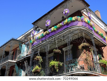 Typical French Quarter wrought iron balconies in preparation for Mardi Gras
