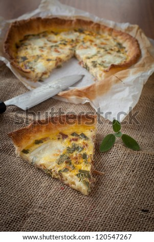 Typical french quiche cake with ham and sage