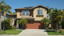 Typical generic suburban single family tract home with built-in garage in California