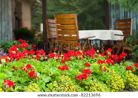 Typical German Garden with wooden garden furniture