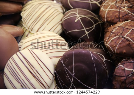 Typical German gingerbread cookies at Christmas called Elisen Lebkuchen or Pfefferkuchen. Sold at local markets the traditional cookies are with spices, chocolate, nuts and eaten with hot mulled wine