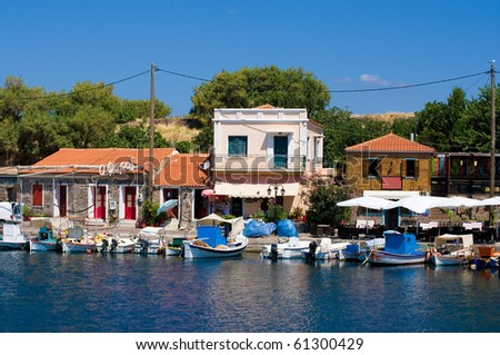 typical greek fishing harbor in the town of molyvos, lesvos, greece
