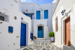 Typical Greek house with blue windows and doors on whitewashed street in beautiful Lefkes village on Paros island. Cyclades, Greece
