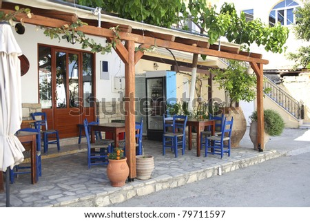 Typical Greek taverna with outdoor seats in Crete