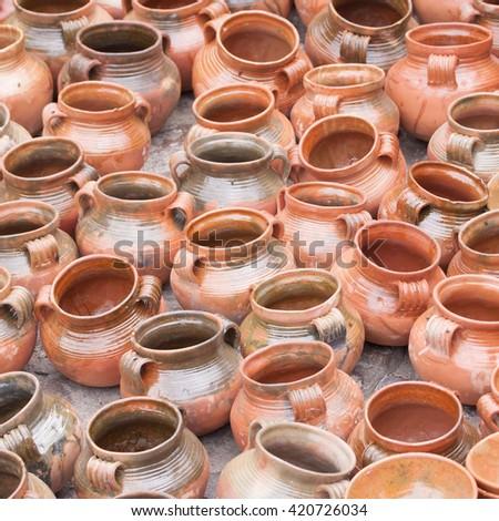 Typical handmade ceramic clay pots at Chichicastenango market in Guatemala
