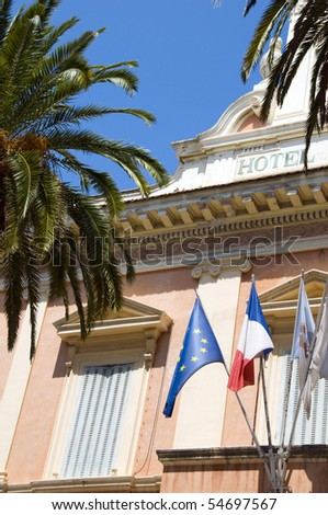 typical historic architecture with palm trees national flag Ajaccio Corsica France