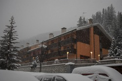 Typical houses or blocks in italian part of dolomites for hotels or apartments, during the heavy snow storm in winter.