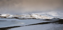 Typical Icelandic landscape with mountains and meadow land covered in snow at snaefellsnes peninsula in Iceland