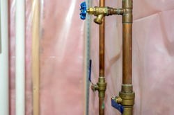 Typical installation of a sprinkler system connected to the main water system with a valve and drain.