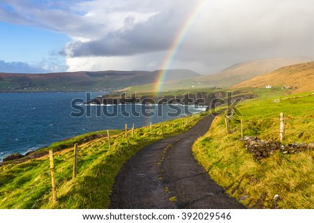 Typical Ireland - Coast, green grass, blue skies, clouds, rain coming, rainbow. Beautiful, amazing, breathtaking.
