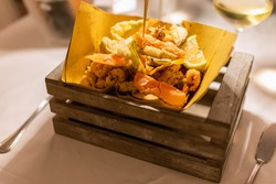 Typical Italian appetizer (Fritto misto di pesce) mix of fried seafood
