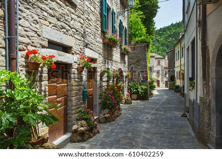 typical Italian street in a small provincial town of Tuscan, Italy, Europe #610402259