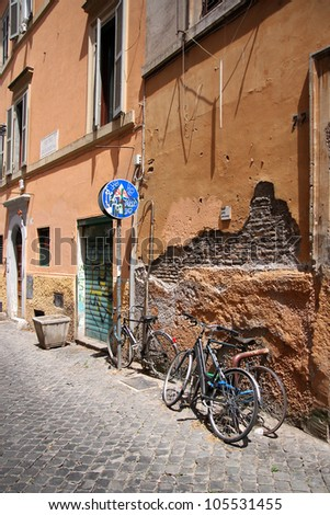 typical italian street with bikes under the wall