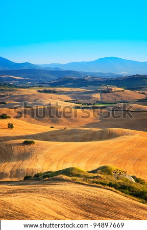 Typical landscape of Tuscany with field and rolling hills near Volterra, Italy.
