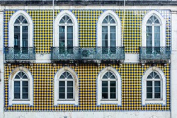 typical lisbon architecture. tile azulejos facade with old windows and balcony. portugal