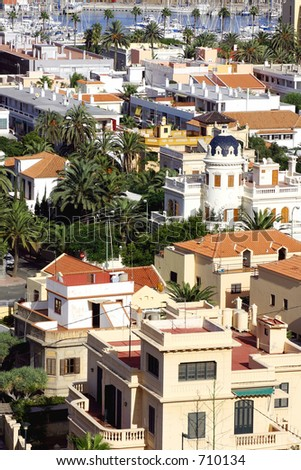 Typical mediterranaean town with red roof tiles and palm trees