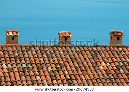Typical mediterranean style roof with the blue ocean as a background.