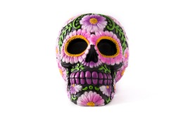 Typical Mexican skull painted isolated on white background. Dia de los muertos.
