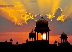 Typical Mogul design palace domes at sunset, Rajasthan, India.