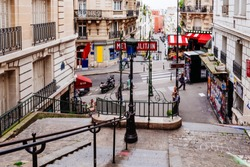 Typical Montmartre staircase and entrance to Paris Metro subway in Paris, France. Architecture and landmarks of Paris. Postcard of Paris