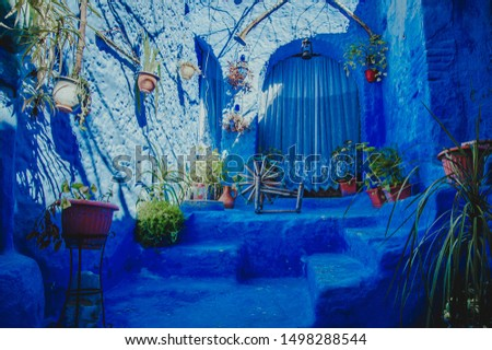Typical moroccan building with living space in Chefchaouen blue city medina in Morocco with blue walls, doors, windows