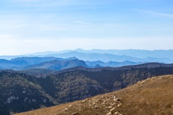 Typical mountain ranges at summer time. Blue landscape, sunny day with no one on the picture. Dry weather by the Mediterranean sea. Mountain layers. Serra de Llaberia, Tarragona, Catalonia, Spain
