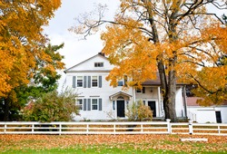 Typical New England colonial style house in the fall