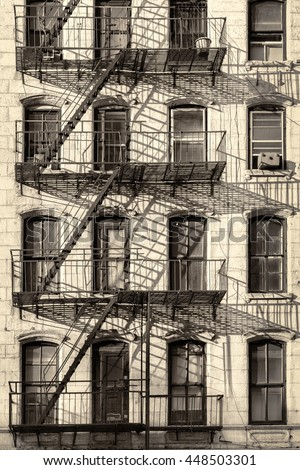 Typical New York City building with fire escape ladders