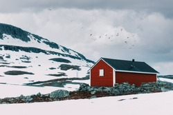 Typical norwegian red wooden house near famous Aurlandsvegen (Bjorgavegen) mountain road in Aurland, Norway in summer time