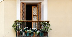 Typical oldtown balcony with flower pots in Andalusia, Spain