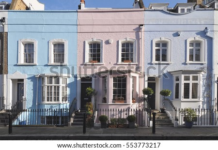 Typical painted facades of small old Chelsea town houses at Bywater Street in the Royal Borough of Kensington and Chelsea, London, UK. #553773217