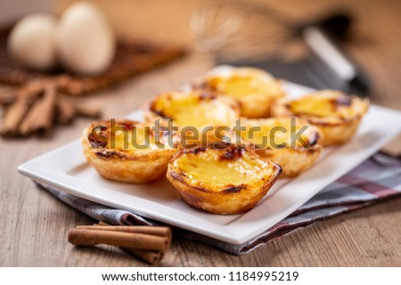 "Typical Portuguese custard pies - ""Pastel de Nata"" or ""Pastel de Belem"". traditional portuguese pastry. #1184995219"