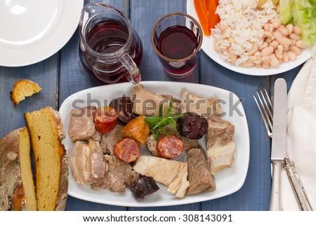 Shutterstock typical portuguese dish cozido a portuguesa and red wine