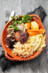 typical portuguese dish cozido a portuguesa on ceramic dish
