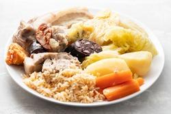 typical portuguese dish cozido a portuguesa on white dish