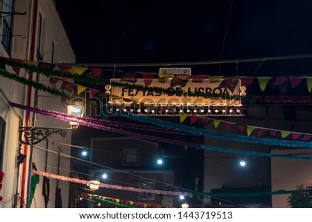 """Typical portuguese Popular Saints decoration in a street with the Text """"Lisbon Festival"""""""