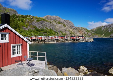 Typical red rorbu fishing huts in village of Nusfjord, unesco heritage on Lofoten islands, Norway