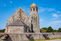 Typical rural church in Normandy, France. French countryside tourism concept. Religious background.