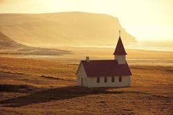 Typical Rural Icelandic Church at Sea Coastline. Horizontal shot