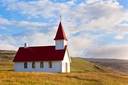 Typical Rural Icelandic Church under a blue summer sky. Horizontal shot