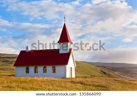 Typical Rural Icelandic Church under a blue summer sky. Horizontal shot