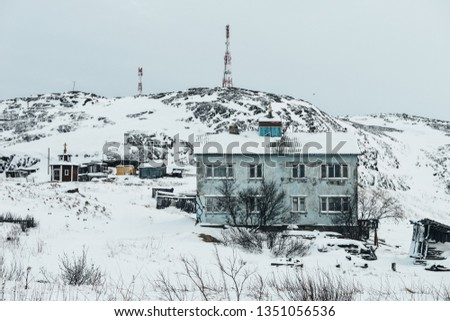 typical Russian residential house in cold winter in Teriberka, Russia