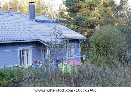 Typical scandinavian blue wooden house in Finland