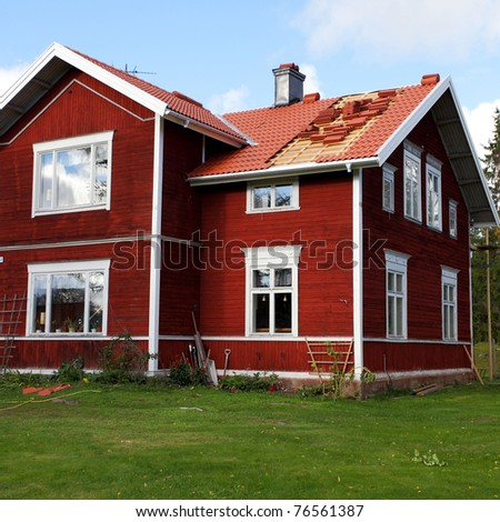 Typical scandinavian  red wooden cottage