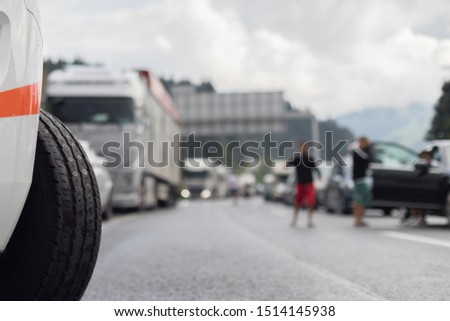 Typical scene on European highways during summer holiadays rush hour. A traffic jam with rows of cars tue to highway car accident. Empty emergency lane. Shallow depth of field. #1514145938