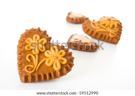 Typical Slovenian honeybread - heart shaped cookies on white background.
