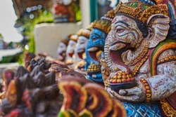Typical souvenir shop selling souvenirs and handicrafts of Bali at the famous Ubud Market, Indonesia. Balinese market. Souvenirs of wood and crafts of local residents. Wooden statues made from wood.