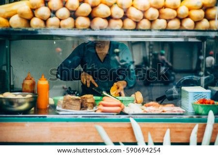 Typical street food in Hanoi, Vietnam #590694254
