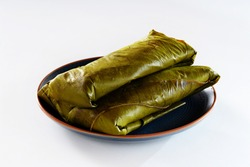 typical tamale wrapped in banana leaf